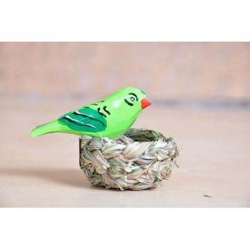 Ludowy ptaszek z gniazdkiem zieleń